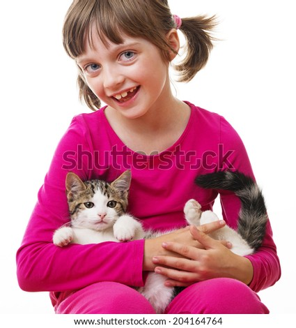 little girl holding a kitten - stock photo