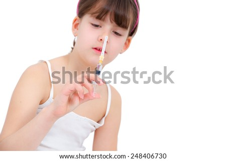 Little girl holding in her hand a vaccine - stock photo