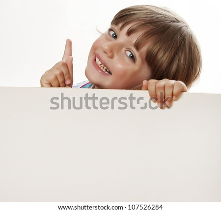 little girl holding  white board with empty space for text or picture - stock photo