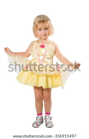 Little girl in a beautiful yellow dress and crown isolated on white background.