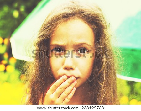 Little girl is shocked and surprised . Toned - stock photo