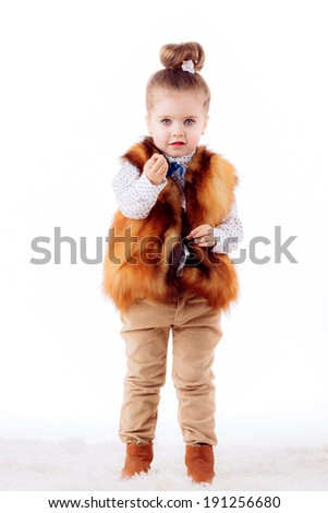 little girl on a white background. fashion portrait. isolated   - stock photo