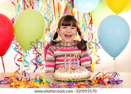 little girl with birthday cake and balloons - stock photo