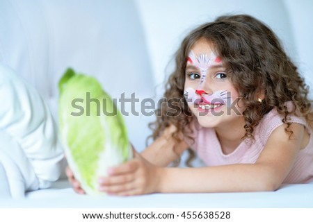little girl with face painted - stock photo