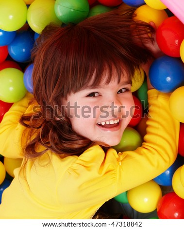 Little girl with group ball. Play room. - stock photo