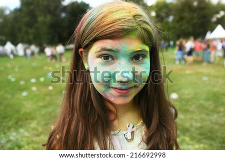 little pretty girl with painted face - stock photo