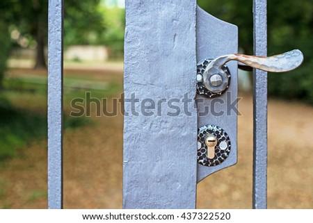 Lock and metal door handle in closed Park gates, Schwetzingen, Germany - stock photo
