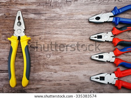 Locking pliers on wooden background, Prepare basic hand tools for work. - stock photo
