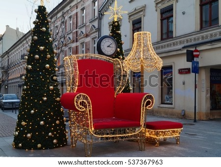 LODZ, POLAND 12 DECEMBER 2016 : At the corner of Piotrkowska and 6th August.Beautiful Christmas decoration . Nicholas chair where everyone will be happy to make commemorative photos