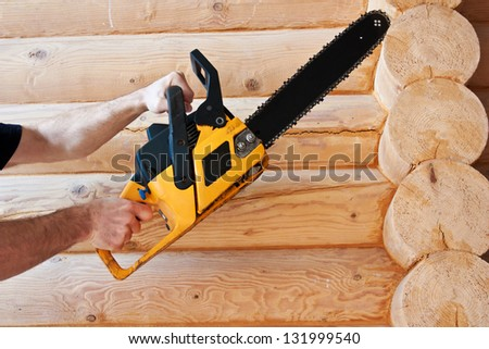 logging, worker  with  chainsaw - stock photo