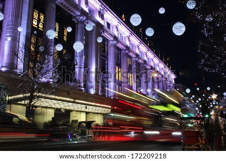 London at night. Long exposure shot of blurred bus speeding through night street. - stock photo