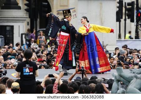 LONDON - AUGUST 9: Korean ethnic dancers perform,Royal Wedding Dance, in Korean Festival at Trafalgar Square on August 9, 2015 in London, UK.   - stock photo