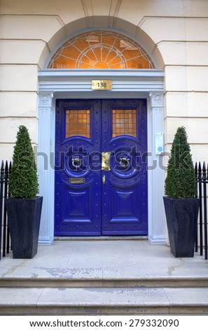 London, England - April 30, 2015: Typical Georgian entrance to the London Vision Clinic in Harley Street. London. Harley Street has a global reputation for private medical and health services