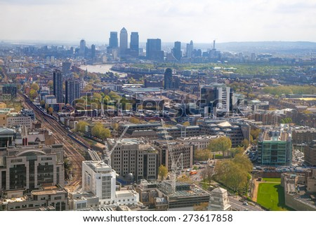 LONDON, UK - APRIL 22, 2015: Canary Wharf in early morning. Panoramic view East London - stock photo