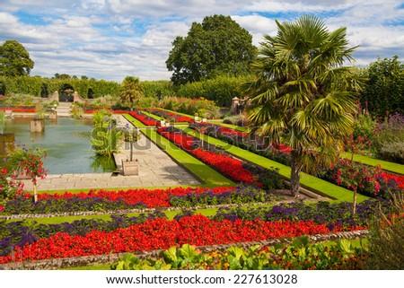 LONDON, UK - AUGUST 16, 2014: Kensington palace and gardens - stock photo