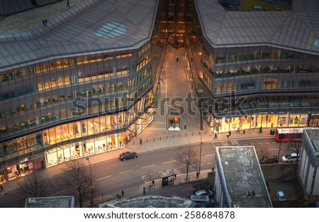 LONDON, UK - JANUARY 27, 2015: Busy streets of City of London in the dusk. First evening lights and sunset. London's panorama from the St. Paul cathedral - stock photo