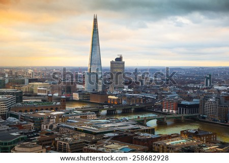 LONDON, UK - JANUARY 27, 2015: City of London and Shard of glass in sunset. London's panorama. View from the St. Paul cathedral - stock photo
