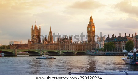 LONDON, UK - July 21, 2014: London at sunset.  Big Ben and houses of Parliament - stock photo