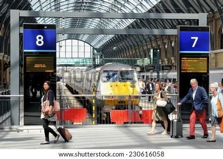 LONDON, UK - JULY 9, 2014:Tourists arrive at King's Cross St. Pancras International train station. - stock photo
