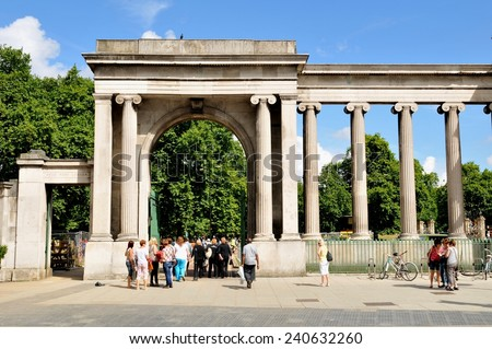 LONDON, UK - JULY 9, 2014: Tourists enter the famous Hyde Park in London.  - stock photo