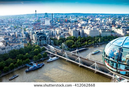 LONDON, UK - JUNE 6, 2015: Aerial cityscape  over the river Thames near Haugerford   Bridge with Charing Cross Station and  tourist pleasure boats