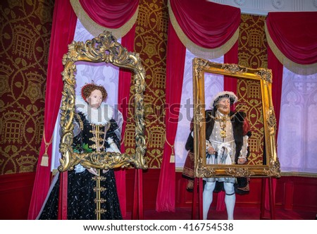LONDON , UK - JUNE 7, 2015:  King Henry 8th  and Queen Elizabeth I   wax figures  At Madame Tussauds  Museum - stock photo