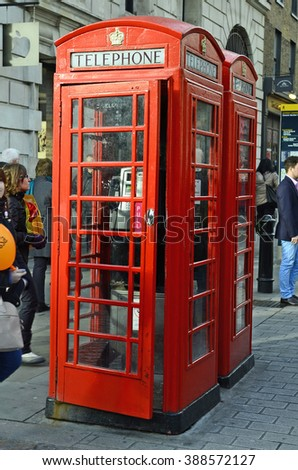 :LONDON, UNITED KINGDOM - JANUARY 16: Unidentified people and traditional telephon cell at Covent Garden, on January 16, 2016 in London, England