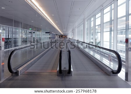 long horizontal escalator at international airport terminal - stock photo
