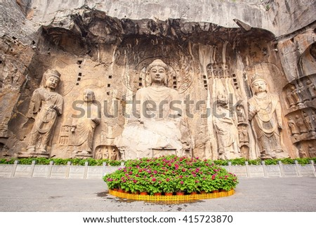"Longmen Grottoes- Fengxiang temple stone Buddhas. It is a world cultural heritage. One of China's four most famous ""Buddhist Caves Art Treasure Houses"", is located Luoyang, Henan, China. - stock photo"