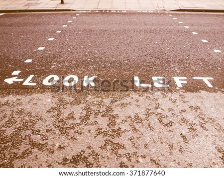 Look Left warning at a pedestrian zebra crossing in a London street vintage - stock photo