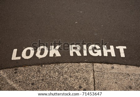 """Look Right"", sign on road edge advising safety for pedestrians. - stock photo"