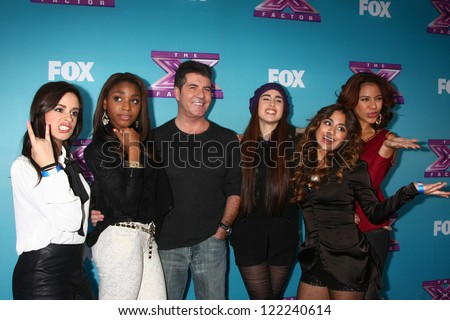 .LOS ANGELES - DEC 17:  Fifth Harmony, Simon Cowell at the 'X Factor' Season Finale Press Conference at CBS Television City on December 17, 2012 in Los Angeles, CA - stock photo