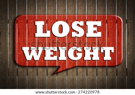 """  lose weight "" on red speech bubble wood on wood background - stock photo"