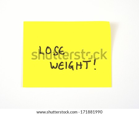 'Lose Weight' written on a yellow sticky note - stock photo