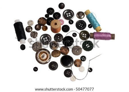 lot of buttons and threads on a white background - stock photo