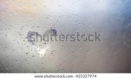 """""""Love rain and bokeh light"""", view through the windshield of strong rainy day. Abstract of defocused bokeh lights background. - stock photo"""