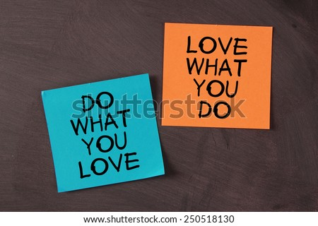 'Love What You Do and Do What You Love' notes pasted on blackboard. - stock photo