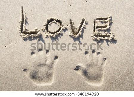 """""""Love"""" written on sand beach - stock photo"""