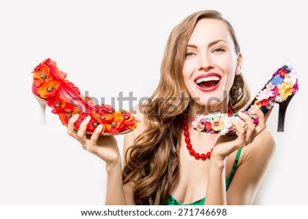 Lovely woman with high heels shoes isolated over white - stock photo