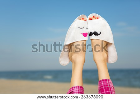 Loving couple legs on the beach. Dreaming about summer beach love story and new boyfriend concept - stock photo