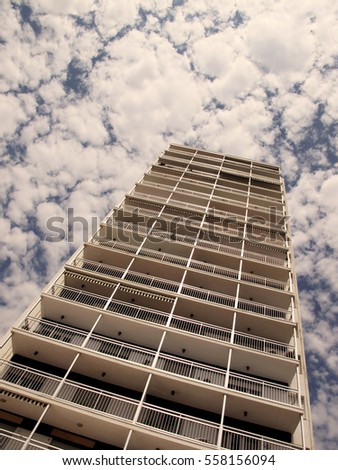 Low angle of building, sky with clouds