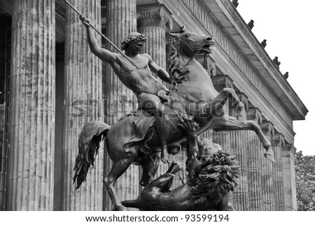 """Lowenkampfer"" (""Lion-fighter""), Altes Museum (Old Museum) located on Museum Island, a UNESCO-designated World Heritage Site on Berlin, Germany - stock photo"