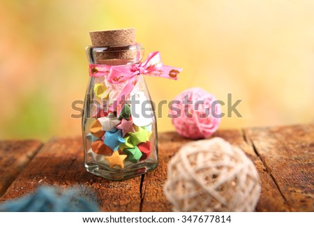 luck star and glass bottle