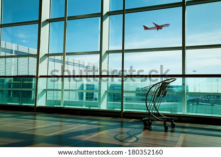 luggage cart in airport interior - stock photo