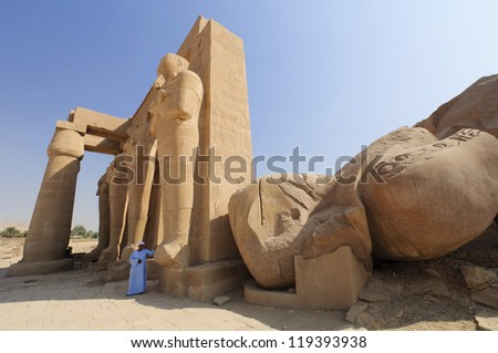 LUXOR, EGYPT - OCT 7: The Ramesseum on the Nile's West Bank near Luxor in Egypt on October 7, 2012 is the memorial temple of the Pharaoh Ramesses II. - stock photo