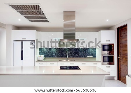 Luxury interior design pool villa in kitchen area which feature island counter and built in furniture