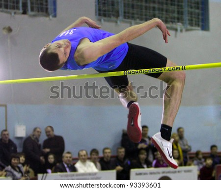 LVIV, UKRAINE - JAN. 20: Theiner Wojciech from Ruda, Poland competes in high jump competition on the International Memorial Demyanyuk track and field meeting, on January 20, 2012 in Lviv, Ukraine. - stock photo