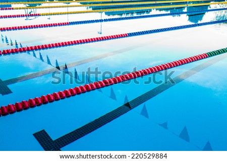 50m Olympic Outdoor Pool Corridor Cables Floating and Calm Water - stock photo
