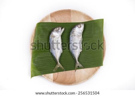 mackerel fish on banana leaf - stock photo