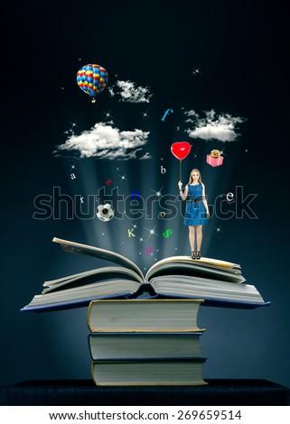 Magic book. Image of opened magic book with magic lights - stock photo